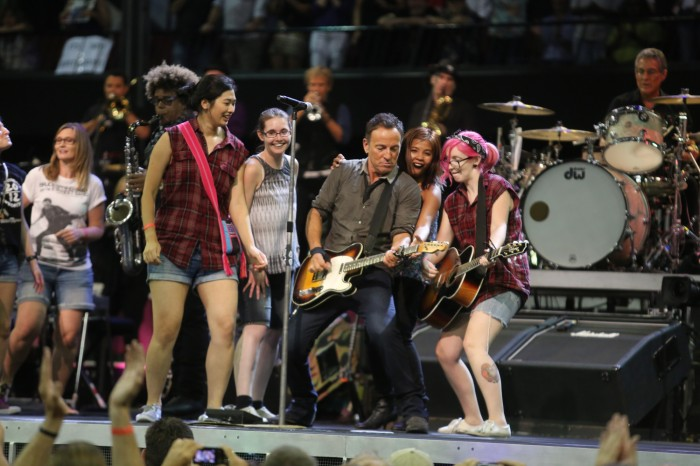 Aimee Knight (right) on stage with Bruce Springsteen in 2014. Image: Supplied
