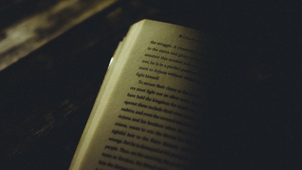 A page of a book, half in shadow.